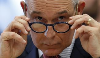 Environmental Protection Agency Administrator Scott Pruitt removes his glasses as he testifies at a hearing of the House Appropriations subcommittee for the Interior, Environment, and Related Agencies, on Capitol Hill, Thursday, April 26, 2018 in Washington. (AP Photo/Alex Brandon) ** FILE **