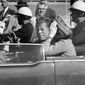 FILE - In this Nov. 22, 1963 file photo, President John F. Kennedy waves from his car in a motorcade in Dallas. Riding with Kennedy are First Lady Jacqueline Kennedy, right, Nellie Connally, second from left, and her husband, Texas Gov. John Connally, far left. The National Archives released the John F. Kennedy assassination files on Thursday, Oct. 26, 2017. (AP Photo/Jim Altgens, File)