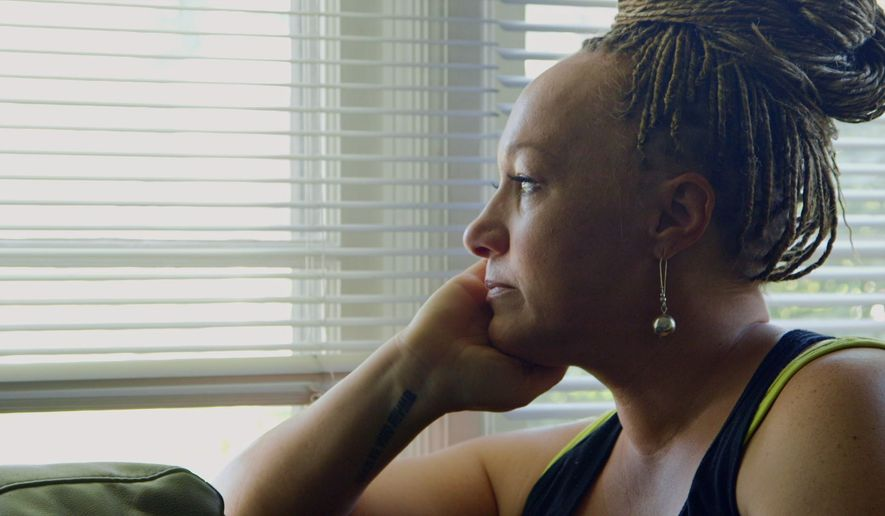 """This image released by Netflix shows Rachel Dolezal in a scene from the documentary """"The Rachel Divide,"""" premiering April 27. (Netflix via AP)"""