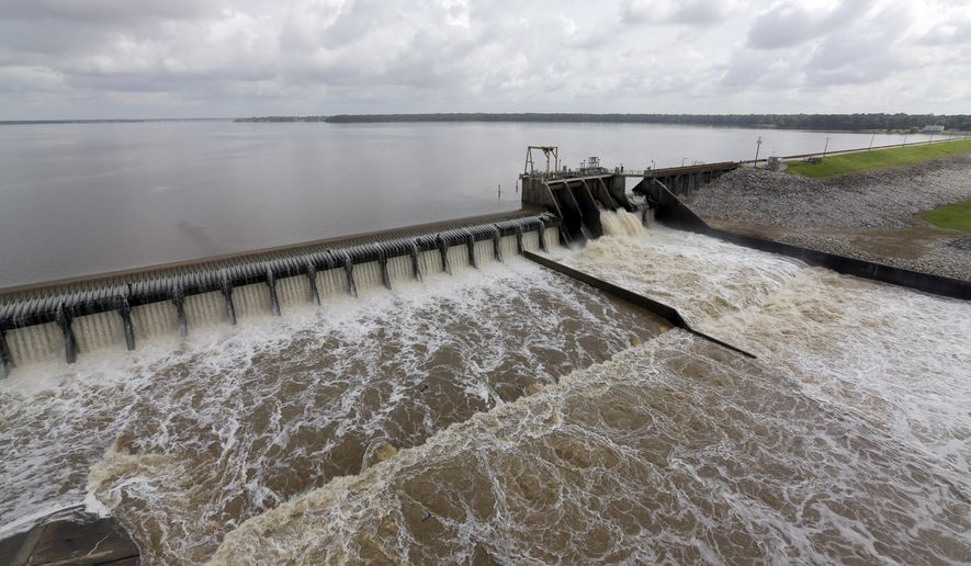 Water flows over the spillway from Lake Houston into the San Jacinto River Saturday, May 30, 2015, in Houston. The Colorado River in Wharton and the Brazos and San Jacinto rivers near Houston are the main focus of concern as floodwaters moved from North and Central Texas downstream toward the Gulf of Mexico. (AP Photo/David J. Phillip)