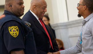 Actor and comedian Bill Cosby, center, is greeted as he arrives at the Montgomery County Courthouse for jury deliberations in his sexual assault retrial, Thursday, April, 26, 2018, in Norristown, Pa. (Mark Makela//Pool Photo via AP)