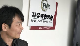 Choi Jung-hoon, a former North Korean army official who defected to South Korea in 2006, helps run Free North Korea Radio, which has been piping news into the North. (Guy Taylor/The Washington Times)