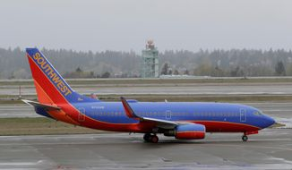 In this April 13, 2018, file photo, a Southwest Airlines plane taxis at the Seattle-Tacoma International Airport in Seattle. (AP Photo/Ted S. Warren) ** FILE **