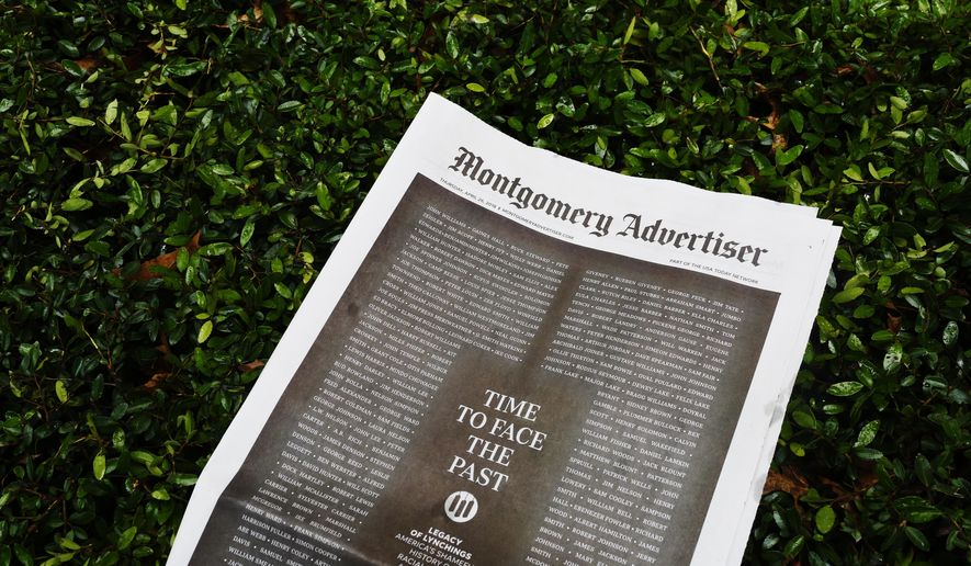 The Montgomery Advertiser newspaper lays on a hedge on Thursday, April 26, 2018, in Montgomery, Ala. (AP Photo/Brynn Anderson)