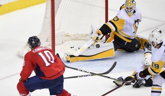 Pittsburgh Penguins goaltender Matt Murray (30) reaches for the puck as Washington Capitals right wing Brett Connolly (10) watches during the third period in Game 1 of an NHL second-round hockey playoff series, Thursday, April 26, 2018, in Washington. The Penguins won 3-2. (AP Photo/Nick Wass) ** FILE **