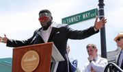 In this June 22, 2017, file photo, retired Boston Red Sox designated hitter David Ortiz is honored with the renaming of a portion of Yawkey Way to David Ortiz Drive outside Fenway Park in Boston. The City of Boston approved a plan Thursday, April 26, 2018, to change the name of Yawkey Way to Jersey Street, it's original name. The street had been named in honor of former Red Sox owner Tom Yawkey, who some have said was racist. At center rear is Boston Mayor Marty Walsh, and at right is Red Sox principal owner John Henry. (AP Photo/Charles Krupa, File) **FILE**