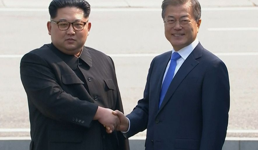 In this image taken from video provided by Korea Broadcasting System (KBS)  Friday, April 27, 2018, North Korean leader Kim Jong Un, left,  shakes hands with South Korean President Moon Jae-in as Kim crossed the border into South Korea for their historic face-to-face talks, in Panmunjom. Their discussions will be expected to focus on whether the North can be persuaded to give up its nuclear bombs.(Korea Broadcasting System via AP)