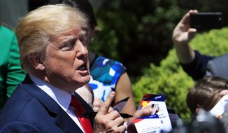 """President Donald Trump is surrounded by children as he talks in the Rose Garden in celebration of """"Bring Our Daughters and Sons to Work Day"""" at the White House in Washington, Thursday, April 26, 2018. (AP Photo/Manuel Balce Ceneta)"""