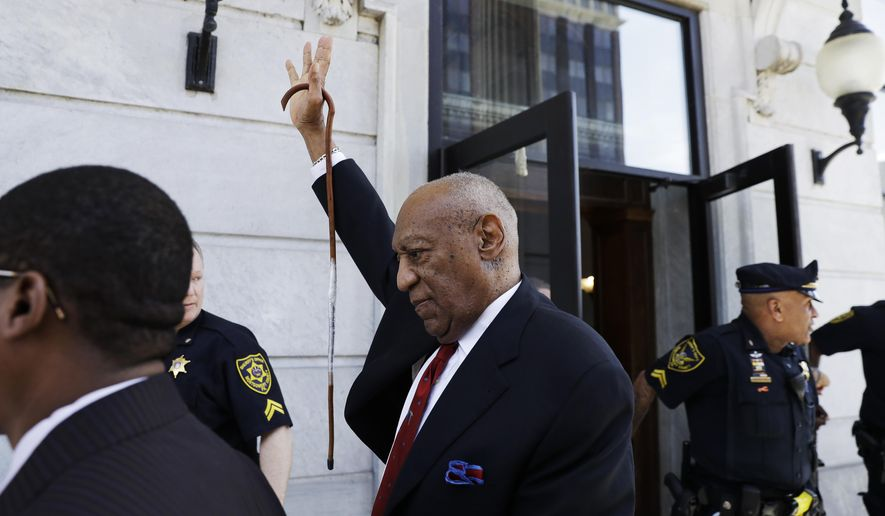 Bill Cosby gestures as he leaves the Montgomery County Courthouse in Norristown, Pa., after being convicted of drugging and molesting a woman, Thursday, April 26, 2018. (AP Photo/Matt Slocum)
