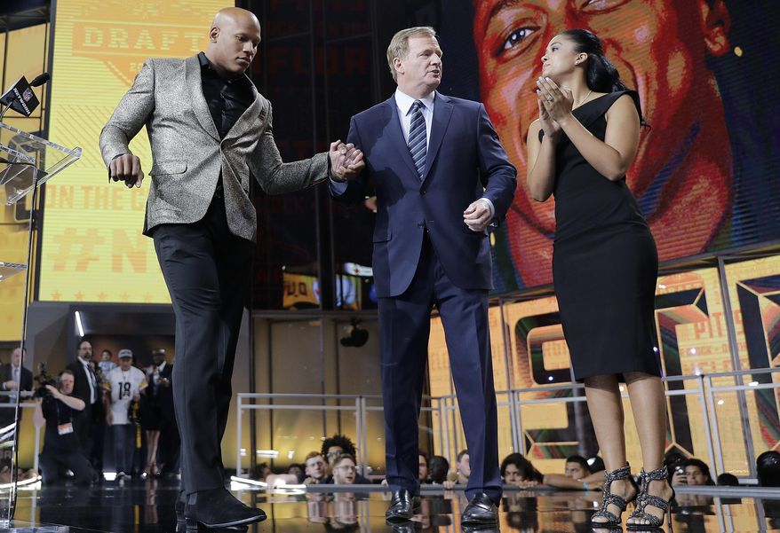 Ryan Shazier, left, and his wife Michelle, right, stand with commissioner Roger Goodell, during the Pittsburgh Steelers' selection in the first round of the NFL football draft, Thursday, April 26, 2018, in Arlington, Texas. (AP Photo/David J. Phillip)