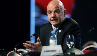 FILE- In this file photo dated Thursday, April 12, 2018, FIFA President Gianni Infantino speaks during the annual conference of the South American Football Confederation, CONMEBOL, in Buenos Aires, Argentina.  Speaking about the upcoming vote to name the host country for the 2026 World Cup, Infantino insists he is impartial. (AP Photo/Martin Ruggiero, FILE)
