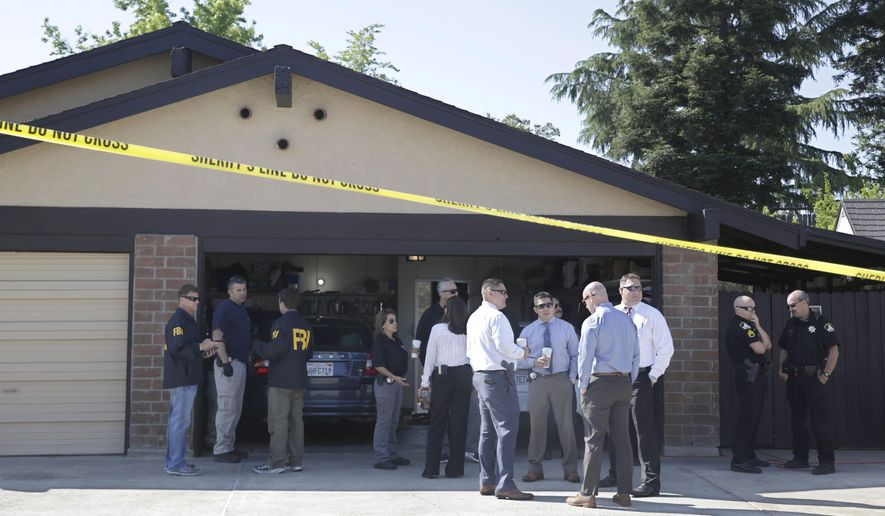Authorities gather outside the home of suspect Joseph James DeAngelo, Wednesday, April 25, 2018, in Citrus Heights, Calif. DeAngelo, 72, was taken into custody, Tuesday, on suspicion of committing at least 12 slayings and 45 rapes in the 1970's and 1980's in California. (AP Photo/Rich Pedroncelli)