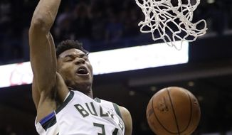 Milwaukee Bucks' Giannis Antetokounmpo dunks during the first half of Game 6 of an NBA basketball first-round playoff series against the Boston Celtics Thursday, April 26, 2018, in Milwaukee. (AP Photo/Morry Gash)