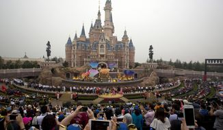 """FILE - In this June 16, 2016 file photo, performers take to the stage during the opening ceremony for the Disney Resort in Shanghai, China. Walt Disney Co. is emphasizing its deep China connections as it launches an extension of Shanghai's $5.5 billion Disney Resort amid rising trade tensions between Washington and Beijing. Bob Weis, a top Disney executive, says most of the labor and materials that went into the new Toy Story Land are from China. """"We're a local company,"""" he said at the April 26, 2018 colorful launch. """"Everything here is built and made in China."""" (AP Photo/Ng Han Guan)"""