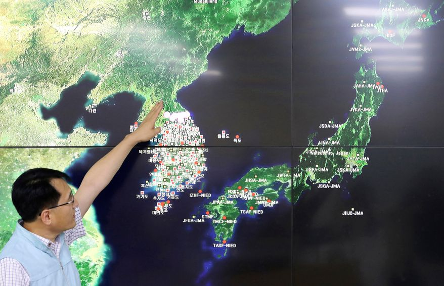 FILE - In this Sept. 3, 2017, file photo, Earthquake and Volcano of the Korea Monitoring Division Director Ryoo Yong-gyu speaks to the media about North Korea's artificial earthquake with a map of the Korean peninsular in Seoul, South Korea. A study by Chinese geologists shows the mountain above North Korea's main nuclear test site has collapsed under the stress of the explosions, rendering it unsafe for further testing and necessitating monitoring for any leaking radiation. The findings by the scientists at the University of Science and Technology of China may shed new light on North Korean President Kim Jong Un's announcement that his country was ceasing its testing program.(AP Photo/Lee Jin-man, File)