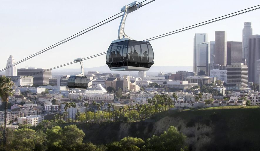 This undated rendering shows a proposed gondola line that would carry passengers from Union Station in Los Angeles to Dodger Stadium. Los Angeles baseball fans would avoid freeway traffic and be whisked by air to Dodger Stadium via gondola, if a plan backed by the mayor moves forward. Supporters of the privately-funded project say the aerial trip from downtown's Union Station would take about five minutes. (Aerial Rapid Transit Technologies LLC via AP)