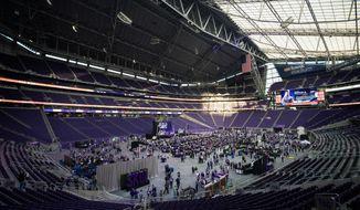 Fans attend  the Minnesota Vikings' NFL football draft party Thursday, April 26, 2018, at U.S. Bank Stadium in Minneapolis. (Carlos Gonzalez/Star Tribune via AP)