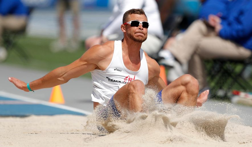 Kurtis Brondyke lands in the pit during the decathlon long jump at the Drake Relays athletics meet, Wednesday, April 25, 2018, in Des Moines, Iowa. (AP Photo/Charlie Neibergall)