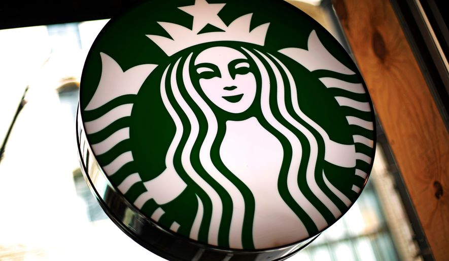FILE- This March 24, 2018, file photo shows a sign in a Starbucks located in downtown Pittsburgh. Starbucks Corp. reports earns on Thursday, April 26, 2018. (AP Photo/Gene J. Puskar, File)