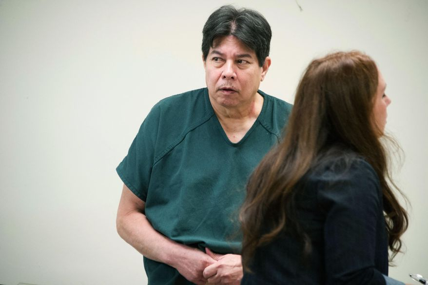 FILE - In this Jan. 16, 2017 file photo Randall Saito, who escaped from a Hawaii psychiatric hospital and flew to California in November 2017, is arraigned from Oahu Community Correctional Center in Honolulu. A court hearing is scheduled Thursday, April 26, 2018, on whether Saito is mentally fit to proceed with trial for escaping from a Hawaii psychiatric hospital and flying to California. Saito was confined to the hospital after he was acquitted by reason of insanity of a woman's 1979 killing. A judge ordered that he go before a panel of examiners to determine whether he can be criminally responsible for the escape. (Craig T. Kojima/The Star-Advertiser via AP, Pool,File)