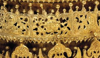 """This undated photo shows a detail of a gold and gilded-copper crown with glass beads from Ethiopia, estimated to be from around 1740, which is part of the """"Maqdala 1868"""" exhibit at London's Victoria and Albert Museum which explores the 1868 British expedition to what was then called Abyssinia. The crown was taken by the British Army during the 1868 Abyssinian Expedition, and has been on display at the V&A since 1872, but the exhibition has caused an outcry in modern Ethiopia. (Victoria and Albert Museum via AP)"""