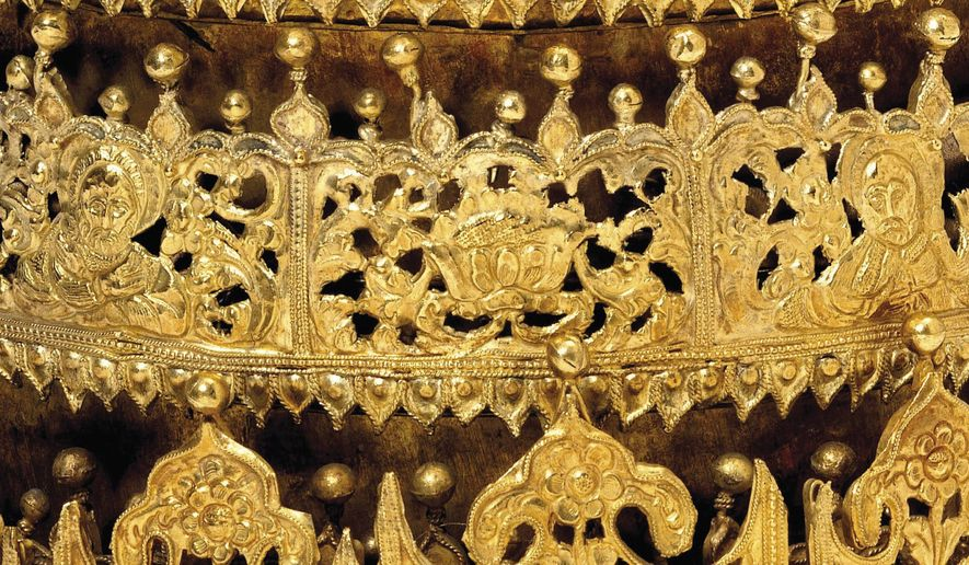 "This undated photo shows a detail of a gold and gilded-copper crown with glass beads from Ethiopia, estimated to be from around 1740, which is part of the ""Maqdala 1868"" exhibit at London's Victoria and Albert Museum which explores the 1868 British expedition to what was then called Abyssinia. The crown was taken by the British Army during the 1868 Abyssinian Expedition, and has been on display at the V&A since 1872, but the exhibition has caused an outcry in modern Ethiopia. (Victoria and Albert Museum via AP)"