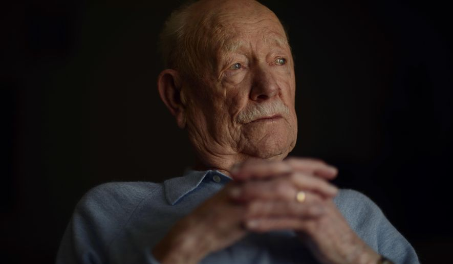 In this April 11, 2018, photo, Armand Sedgeley, 96, poses for a photo in Lakewood, Colo. Even at 96, Sedgeley recalls long-ago events with the clarity of the raw, 22-year-old Army airman he was on the day he fell from the sky over Italy. (Hyoung Chang/The Denver Post via AP)