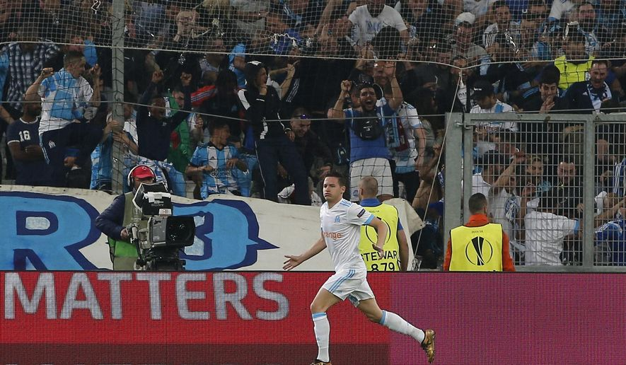 Marseille's Florian Thauvin celebrates after scoring his side's opening goal during the Europa League semifinal first leg soccer match between Olympique Marseille and RB Salzburg at the Velodrome stadium in Marseille, France, Thursday, April 26, 2018. (AP Photo/Thibault Camus)