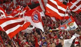 Bayern fans wave flags prior to the semifinal first leg soccer match between FC Bayern Munich and Real Madrid at the Allianz Arena stadium in Munich, Germany, Wednesday, April 25, 2018. (AP Photo/Matthias Schrader)