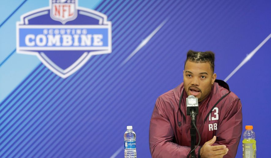 """FILE - In this March 1, 2018, file photo, Louisiana State running back Derrius Guice speaks during a press conference at the NFL football scouting combine in Indianapolis. The NFL has found no evidence that any of its teams asked LSU running back Derrius Guice inapproriate questions during interviews at the scouting combine. Last month, Guice, projected as a first-round selection, told SiriusXM Satellite Radio that one team asked if he was gay and another club asked if his mother """"sells herself."""" (AP Photo/Darron Cummings, File)"""