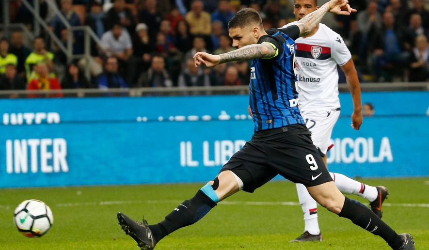FILE - In this April 17, 2018 file photo, Inter Milan's Mauro Icardi scores his side's second goal during an Italian Serie A soccer match between Inter Milan and Cagliari, at the San Siro stadium in Milan, Italy. Amid reports of a dressing-room bust up, Juventus can not afford to slip up at bitter rival Inter Milan on Saturday, April 28, 2018. (AP Photo/Antonio Calanni, file)