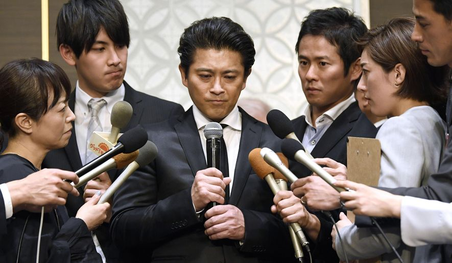 A member of Japanese pop group Tokio, Tatsuya Yamaguchi attends a press conference Thursday, April 26, 2018, in Tokyo.  Yamaguchi acknowledged Thursday that he is facing a criminal investigation related to an allegedly indecent act with a teenage girl. (Daisuke Suzuki/Kyodo News via AP )