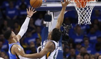 Oklahoma City Thunder guard Russell Westbrook, left, shoots as Utah Jazz guard Donovan Mitchell defends during the second half of Game 5 of an NBA basketball first-round playoff series in Oklahoma City, Wednesday, April 25, 2018. (AP Photo/Sue Ogrocki)