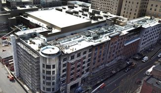 This April 24, 2018 aerial photo shows construction progress on the MGM Casino complex in downtown Springfield, Mass., which is on track to open in August, a few weeks ahead of schedule. MGM Resorts International President Bill Hornbuckle said in a Wednesday interview with The Associated Press that August 24 is the new planned opening date for its $960 million downtown resort complex. The company had previously envisioned opening it sometime in September. (Patrick Johnson/The Republican via AP)