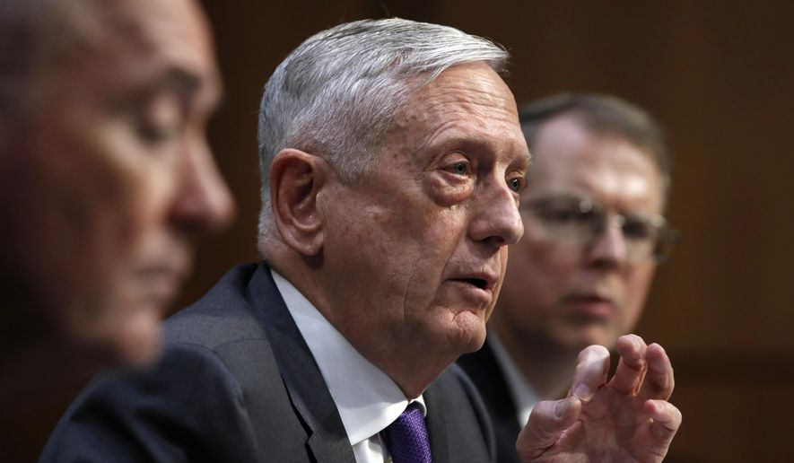Defense Secretary Jim Mattis, center, attends a hearing on the Department of Defense budget posture, with Joint Chiefs Chairman Gen. Joseph Dunford, left, and Defense Under Secretary and Chief Financial Officer David Norquist, right, during a Senate Armed Services Committee hearing, Thursday April 26, 2018, on Capitol Hill in Washington. (AP Photo/Jacquelyn Martin)
