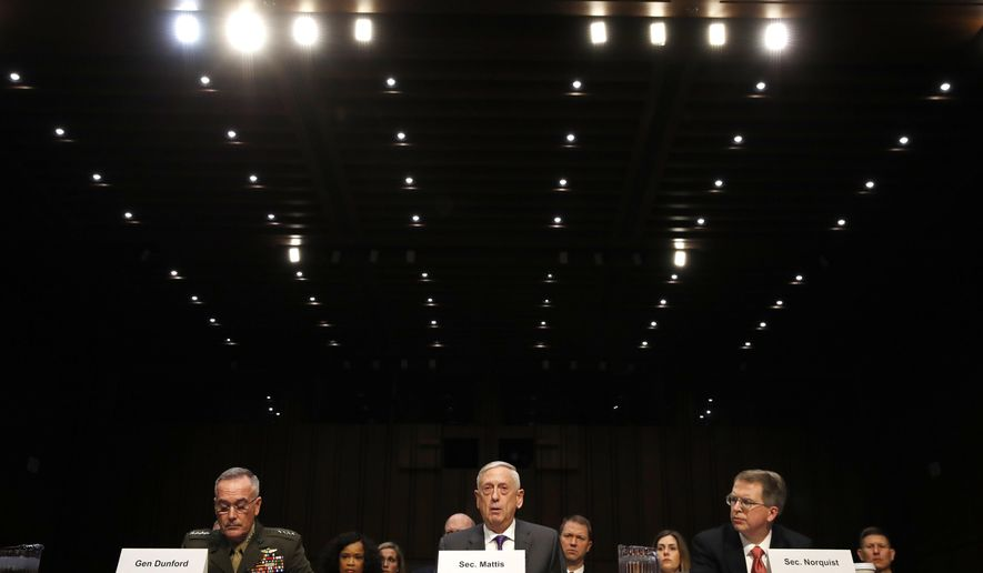 Joint Chiefs Chairman Gen. Joseph Dunford, left, Defense Secretary Jim Mattis, and Defense Under Secretary and Chief Financial Office David Norquist, testify on the Department of Defense budget posture, during a Senate Armed Services Committee hearing, Thursday April 26, 2018, on Capitol Hill in Washington. (AP Photo/Jacquelyn Martin)