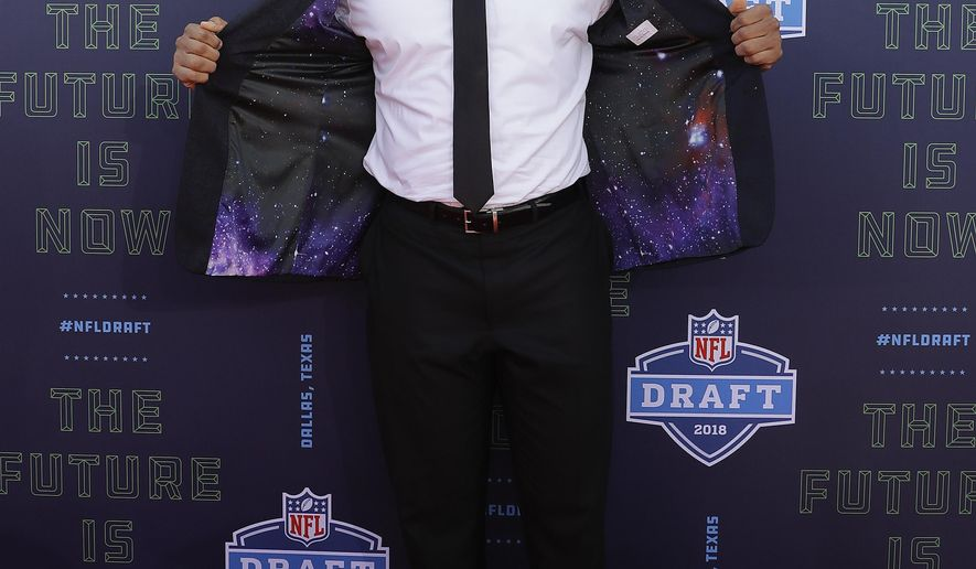 North Carolina State's Bradley Chubb poses for photos on the red carpet before the first round of the NFL football draft, Thursday, April 26, 2018, in Arlington, Texas. (AP Photo/Eric Gay)