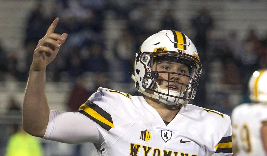 FILE - In this Oct. 22, 2016, file photo, Wyoming quarterback Josh Allen reacts after scoring a touchdown in the second half of an NCAA college football game against Nevada in Reno, Nev. Allen is expected to be a first round pick in the NFL Draft. (AP Photo/Tom R. Smedes, File) **FILE**
