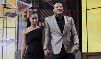 Ryan Shazier, right, walks with his wife Michelle to announce the Pittsburgh Steelers selection in the first round of the NFL football draft, Thursday, April 26, 2018, in Arlington, Texas. (AP Photo/David J. Phillip) ** FILE **