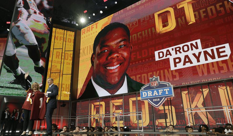 Commissioner Roger Goodell poses with a fan after Da'Ron Payne was selected by the Washington Redskins during the first round of the NFL football draft, Thursday, April 26, 2018, in Arlington, Texas. (AP Photo/David J. Phillip)