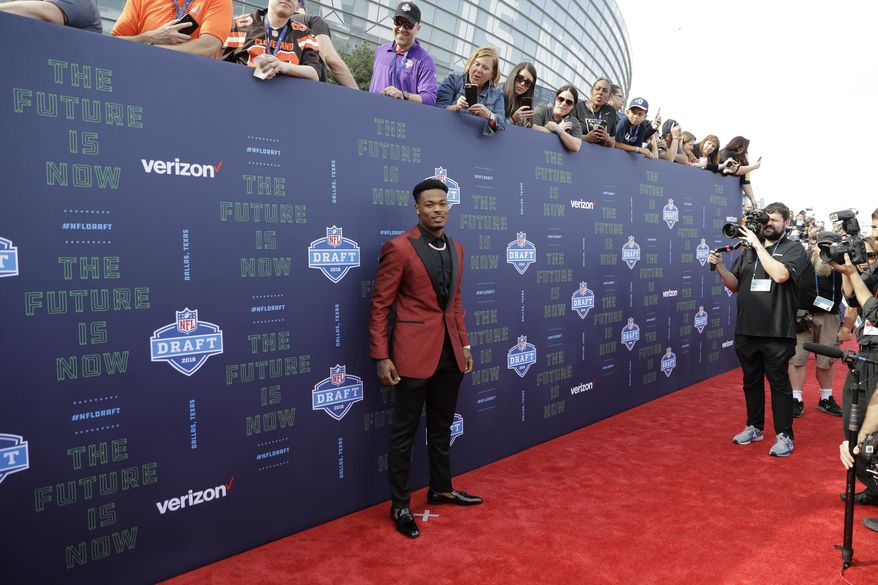 Florida State's Derwin James poses for photos on the red carpet before the first round of the NFL football draft, Thursday, April 26, 2018, in Arlington, Texas. (AP Photo/Eric Gay)