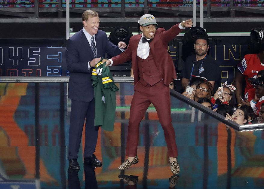 Commissioner Roger Goodell, left, watches as Louisville's Jaire Alexander celebrates after being selected by the Green Bay Packers during the first round of the NFL football draft, Thursday, April 26, 2018, in Arlington, Texas. (AP Photo/Eric Gay)
