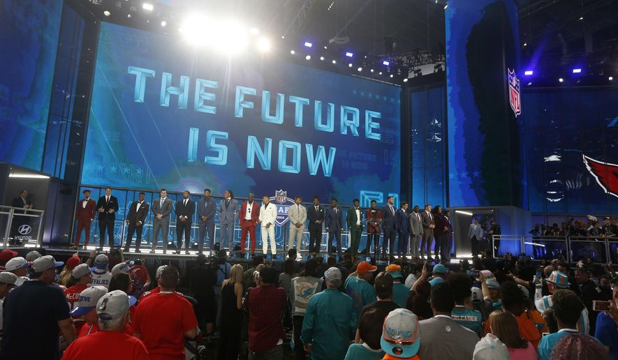 Prospects in attendance stand on stage at the start of the first round of the NFL football draft, Thursday, April 26, 2018, in Arlington, Texas. (AP Photo/Michael Ainsworth)