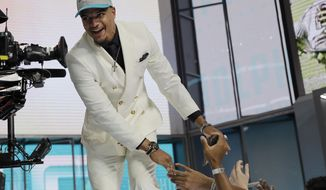 Alabama's Minkah Fitzpatrick walks on stage after being selected by the Miami Dolphins during the first round of the NFL football draft, Thursday, April 26, 2018, in Arlington, Texas. (AP Photo/David J. Phillip)