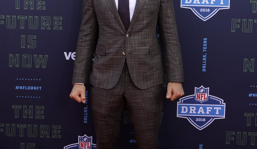 Boise State's Leighton Vander Esch poses for photos on the red carpet before the first round of the NFL football draft, Thursday, April 26, 2018, in Arlington, Texas. (AP Photo/Eric Gay)