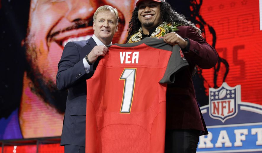 Washington's Vita Vea, right, poses with commissioner Roger Goodell after being picked by the Tampa Bay Buccaneers during the first round of the NFL football draft, Thursday, April 26, 2018, in Arlington, Texas. (AP Photo/David J. Phillip)
