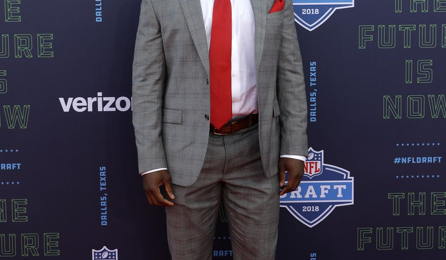 Georgia's Roquan Smith poses for photos on the red carpet before the first round of the NFL football draft, Thursday, April 26, 2018, in Arlington, Texas. (AP Photo/Eric Gay)
