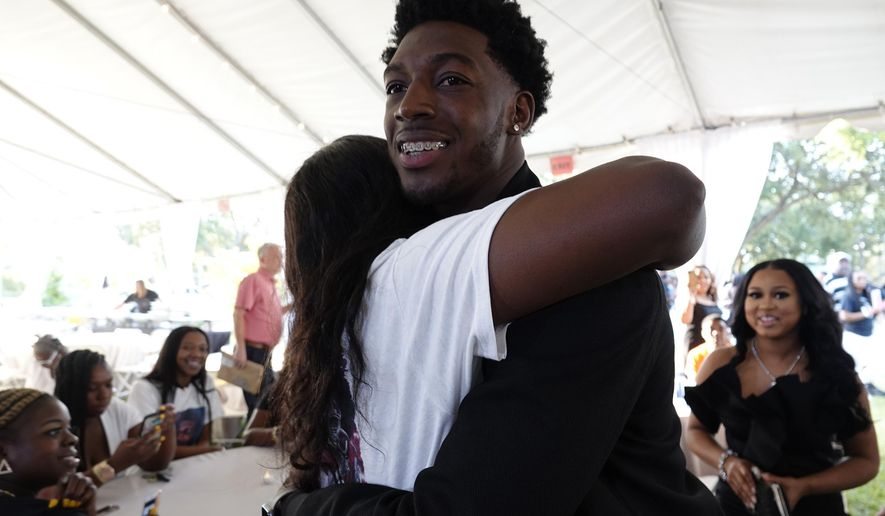 Alabama wide receiver Calvin Ridley is greeted by well-wishers as he arrives for an NFL draft watch party in Fort Lauderdale, Fla., Thursday, April 26, 2018. (Joe Cavaretta/South Florida Sun-Sentinel via AP)