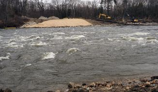 In this April 23, 2018 photo, the removal of the Otsego Township Dam on The Kalamazoo River is underway in Kalamazoo, Mich. The removal was included in the EPA's project to clean up PCB-laden sediments in the Kalamazoo River as part of an the 80-mile Allied Paper/Portage Creek/Kalamazoo River Superfund site, listed on EPA's National Priorities List in August 1990. Polychlorinated biphenyl (PCBs) leftover from processes at paper mills operating on the river beginning in the 1950s is the primary concern targeted in the cleanup. (Mark Bugnaski /Kalamazoo Gazette-MLive Media Group via AP)