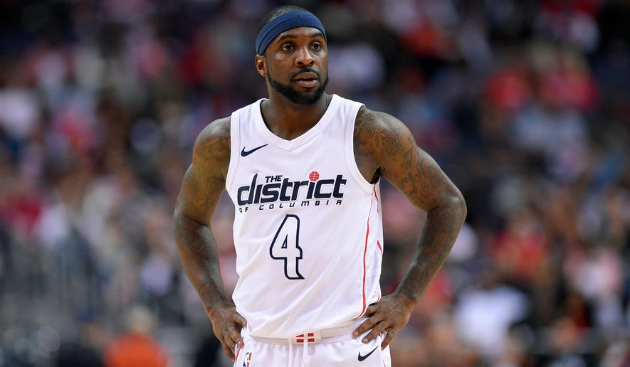 FILE - In this April 22, 2018, file photo, Washington Wizards guard Ty Lawson (4) looks on during the second half of Game 4 of an NBA basketball first-round playoff series against the Toronto Raptors, in Washington. Less than three weeks ago, Lawson was playing professional basketball in China. Nowadays, he's been one of the first subs off the bench for the Washington Wizards in their Eastern Conference first-round playoff series against the No. 1 seed Toronto Raptors (AP Photo/Nick Wass, File)